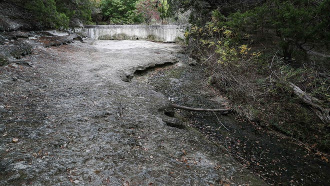 A creek is dried up at Mary Moore Searight Park in Austin on Sunday. Austin's main weather station at Camp Mabry has recorded only about two-thirds of the amount of rain the city normally gets by this point in the fall.