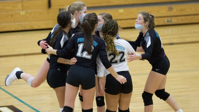 Forestview volleyball players celebrate after winning a point Monday against North Gaston.