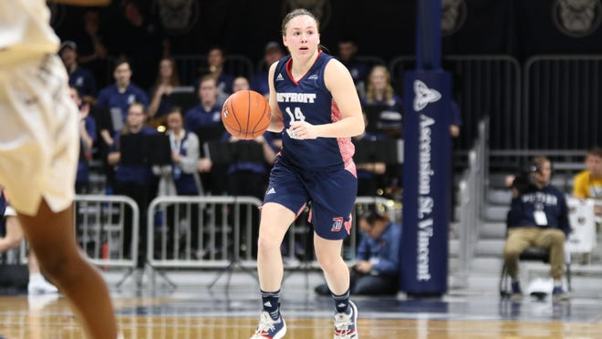 University of Detroit Mercy guard Abbie McDowell (Tecumseh) brings the ball up the floor during a game for the Titans.