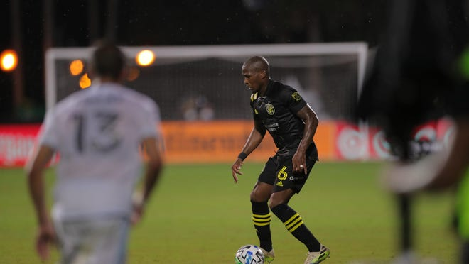 Crew midfielder Darlington Nagbe possesses the ball against Minnesota United in a MLS is Back Tournament round of 16 game on July 28, 2020.