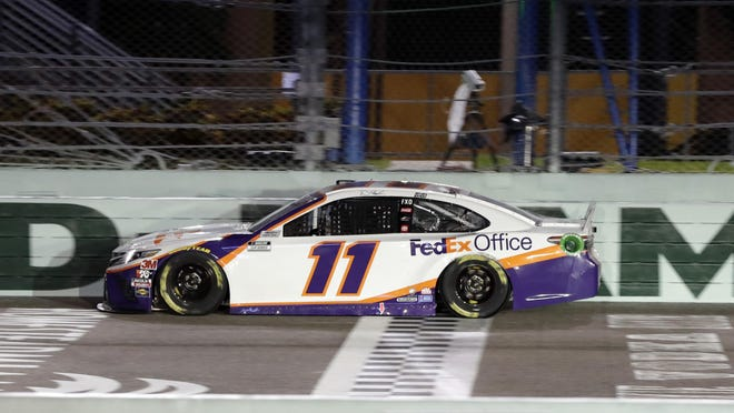 Denny Hamlin crosses the finish line to win a NASCAR Cup Series auto race Sunday, June 14, 2020, in Homestead, Fla.