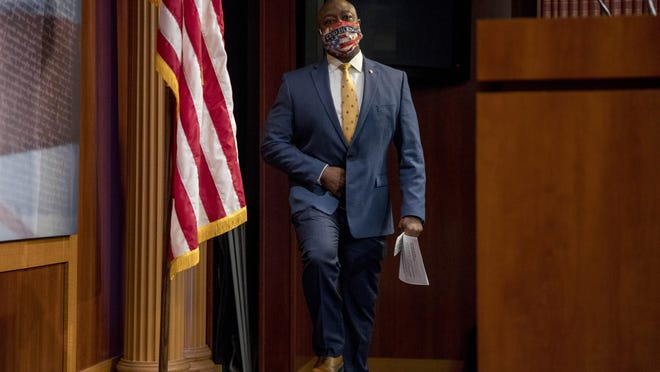 Sen. Tim Scott, R-S.C., arrives at a news conference to announce the introduction of the JUSTICE Act on Capitol Hill, Wednesday, June 17, 2020, in Washington. U.S. Reps. Bill Huizenga, R-Zeeland, and Fred Upton, R-St. Joseph, have co-sponsored the bill.