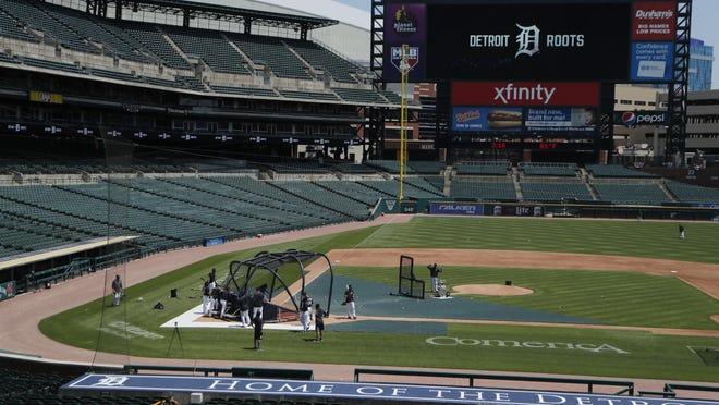 The Detroit Tigers take batting practice during baseball training camp, Monday, July 6, 2020, in Detroit.