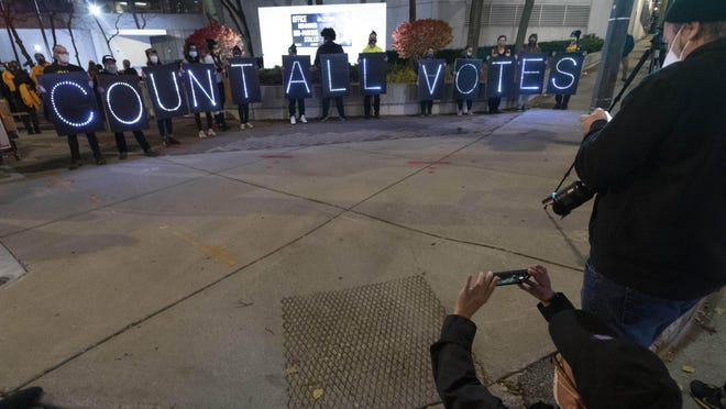 """Nov 3, 2020; Milwaukee, WI, USA; Union members, democracy advocates hold a """"Count Every Vote"""" rally Tuesday, November 3, 2020 outside the City of Milwaukee Central Count Facility, 501 W. Michigan Ave. in Milwaukee, Wis. Split into three shifts, tabulators are positioned in pods of around 50 people to limit the amount of interaction among the hundreds working there because of the coronavirus. Mandatory Credit: Mark Hoffman-USA TODAY NETWORK"""