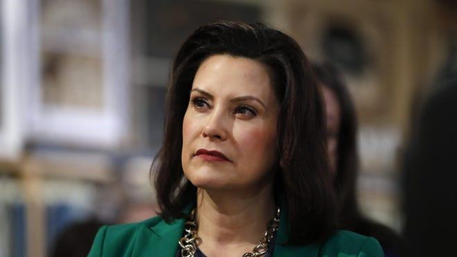 Michigan Governor Gretchen Whitmer listens to Democratic presidential candidate Sen. Kirsten Gillibrand, D-N.Y., in Clawson, Mich., Monday, March 18, 2019.