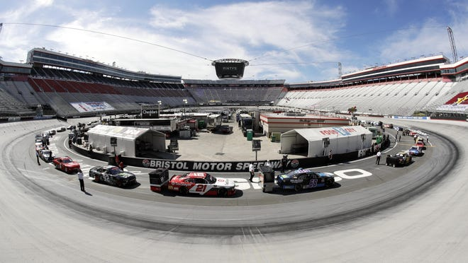 In this picture made with a fisheye lens, cars are readied for a NASCAR Xfinity Series auto race at Bristol Motor Speedway Monday, June 1, 2020, in Bristol, Tenn.