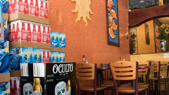 Full cases of beer sat un-used at Case del Sol on Monday. These cases were bought with the expatiation that they would be sold at MuncieGras, however fewer than 8 were actually sold.