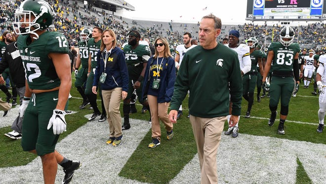 Michigan State coach Mark Dantonio walks of the field after the Spartans' 32-23 loss to Michigan on Oct. 29.