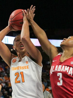 Tennessee center Mercedes Russell, left, tries to shoot near Alabama freshman Jordan Lewis (3) during the second quarter on Thursday at Bon Secours Wellness Arena in Greenville.