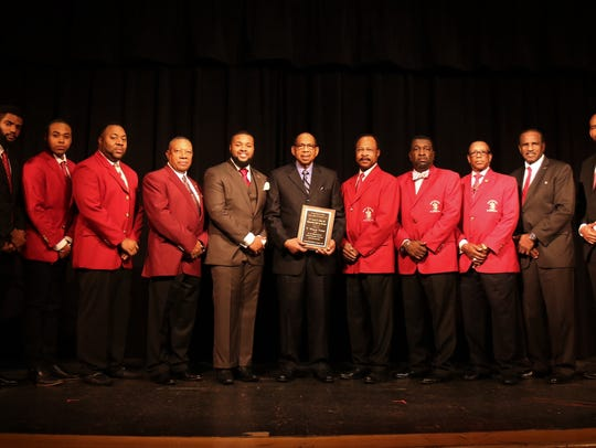 T. Willie Tyson (center), pictured with Jalen Jordan,