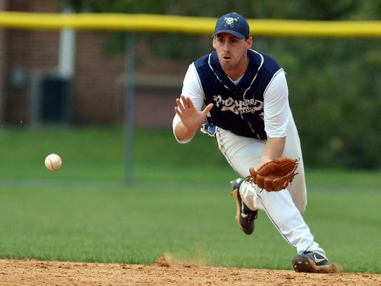 East Prospect's Ryky Smith chases down a grounder from