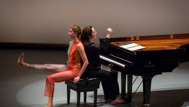 """Dancer Lindsey Jones gets into pianist Simone Dinnerstein's personal space during a performance of """"New Work for Goldberg Variations."""""""