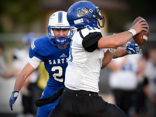 Sartell's Carter Olson concentrates on the Rogers quarterback during the first half of the Friday, Sept. 2, game in Sartell.