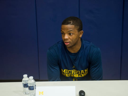 Xavier Simpson answers questions during Michigan Wolverines men's basketball media day in Ann Arbor on Oct. 3, 2016.
