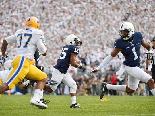 Penn State's Grant Haley returns the ball 42 yards off an overthrown pass against Pittsburgh in the first half of an NCAA Division I college football game Saturday, Sept. 9, 2017, at Beaver Stadium. Penn State defeated Pitt 33-14.