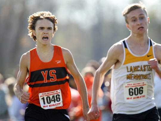 Jarrett Raudensky left, races alongside Lancaster Mennonite's Logan Horst, right, at the District 3 Class 2A championships.