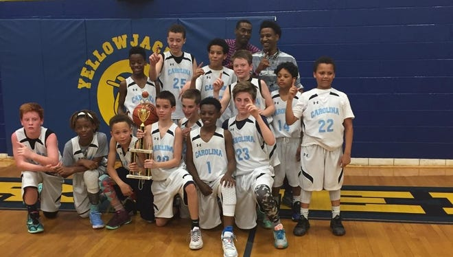 The Team Carolina-Asheville 12 and under boys basketball team won the Tiger Tussle tournament last weekend in Transylvania County.