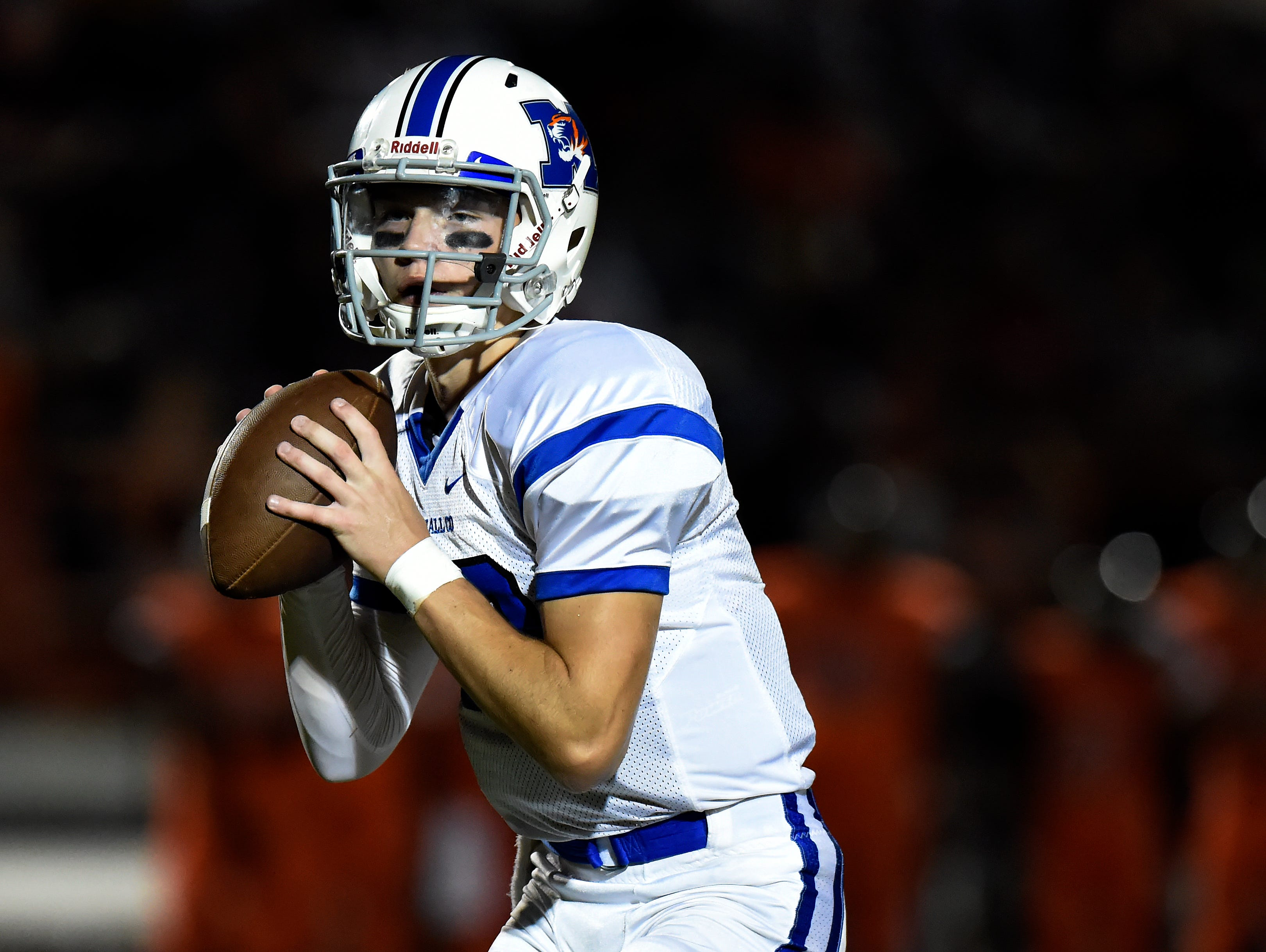 Marshall County quarterback Bryce Wallace drops back to pass during first half of a high school football game against Stratford on Friday, Sept. 23, 2016, in Nashville, Tenn.
