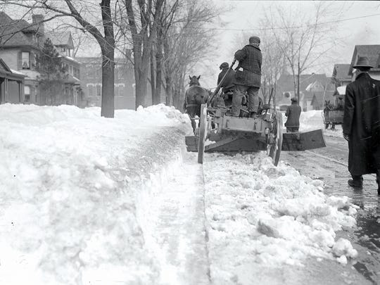 A team of horses pulls a snowplow down South Avenue to clear the street car tracks in March of 1916.