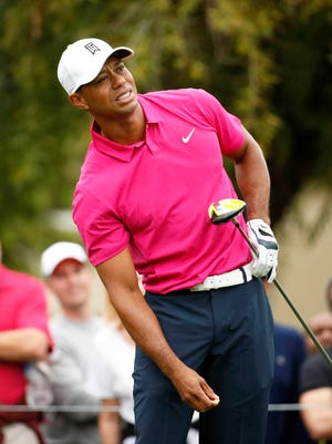 Jan 29, 2015; Scottsdale, AZ, USA; Tiger Woods watches his drive fly into the left rough on the par-4 5th hole during the first round of the Waste Management Phoenix Open at TPC Scottsdale. Mandatory Credit: Rob Schumacher-Arizona Republic via USA TODAY Sports ORG XMIT: USATSI-189602 ORIG FILE ID:  20150129_jla_gan_211.jpg