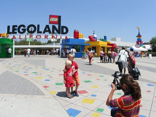 Children stand in front of Legoland California.