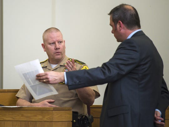 Defense attorney Frank Twarog, right, representing former Burlington police officer Leanne Werner, questions Trooper Charles Schulze, a crash reconstruction expert with the Vermont State Police, in Vermont Superior Court in St. Albans on Tuesday, May 17, 2016, as the court considers a motion to dismiss charges against Werner.  She is accused of driving while intoxicated and crossing into oncoming traffic, killing 74-year-old Omer Martin in July 2015.