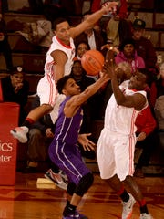 Richmond's Davious Webster, left, and Joel Okafor compete