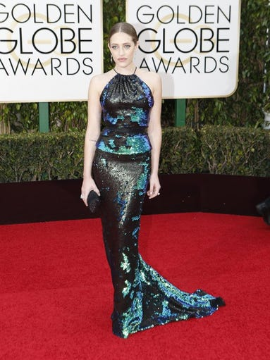 Carly Chaikin arrives at the 73rd Annual Golden Globe Awards show at the Beverly Hilton Hotel in Beverly Hills, Calif., on Sunday.