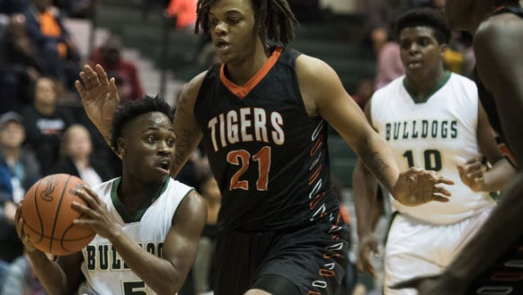 Berea's 5-foot-3 Ja'mious Young (5) drives along the
