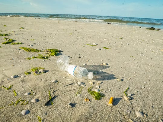 This file from June 2017  photo shows plastic and paper litter on Fort Myers Beach.