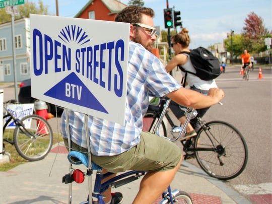 Brennan Guerriere, a North Street resident, rides his bike across the sidewalk toward the street during Sunday's Open Streets event.