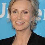 "Jane Lynch of NBC's ""Hollywood Game Night"" arrives at the 2013 NBCUniversal Summer Press Day at The Langham Huntington Hotel and Spa on Monday, April 22, 2013 in Pasadena, Calif. (Photo by Jordan Strauss/Invision/AP)"