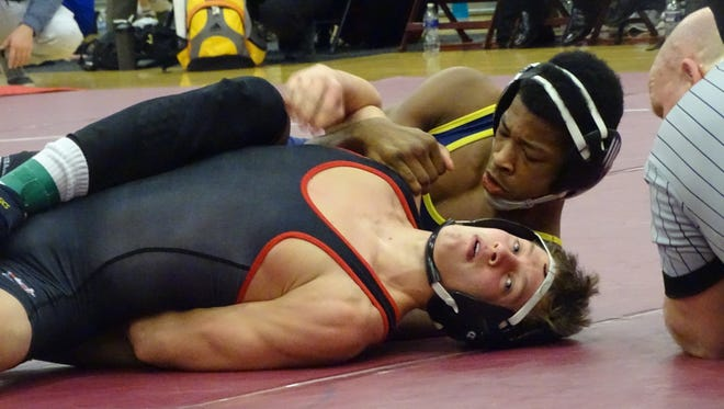 Lancaster freshman Micah Norwood earns a near fall against St. Charles' Kenton Colvin in a 126-pound match Saturday during the Division I sectional tournament at Newark.