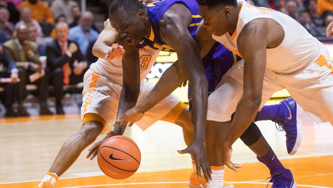 Tennessee guard James Daniell III (3), Tennessee forward Admiral Schofield (5) and LSU forward Duop Reath (1) chase after a loose ball during Tennessee's home basketball game against LSU at Thompson-Boling Arena on Wednesday, January 31, 2018.