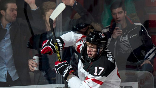 Canada's Connor McDavid celebrates his goal against Germany during the first period of a round-robin game at the hockey World Junior Championship, Saturday in Montreal.