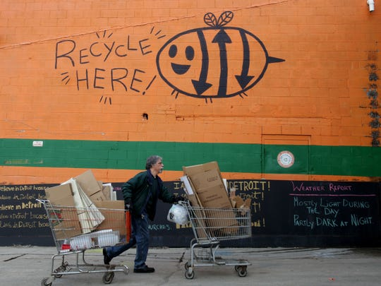 Chris Benvenuti, 57, of St. Clair Shores brings in carts of recyclable materials to Recycle Here! in Detroit.