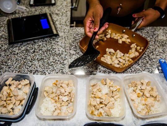 Jordan Beaubrin preps her meals for the day on Thursday,