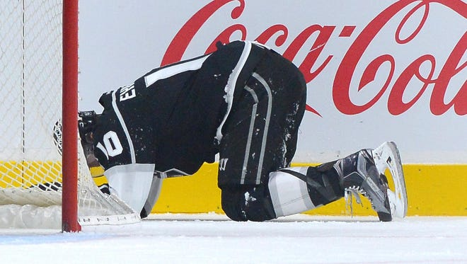Kings defenseman Christian Ehrhoff (10) lays on the ice after a hit in the second period Saturday.