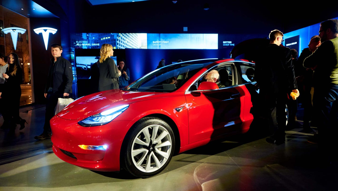 Tesla Model 3 debuts in Chicago