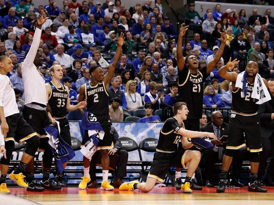 Wichita State Shockers bench players celebrate against
