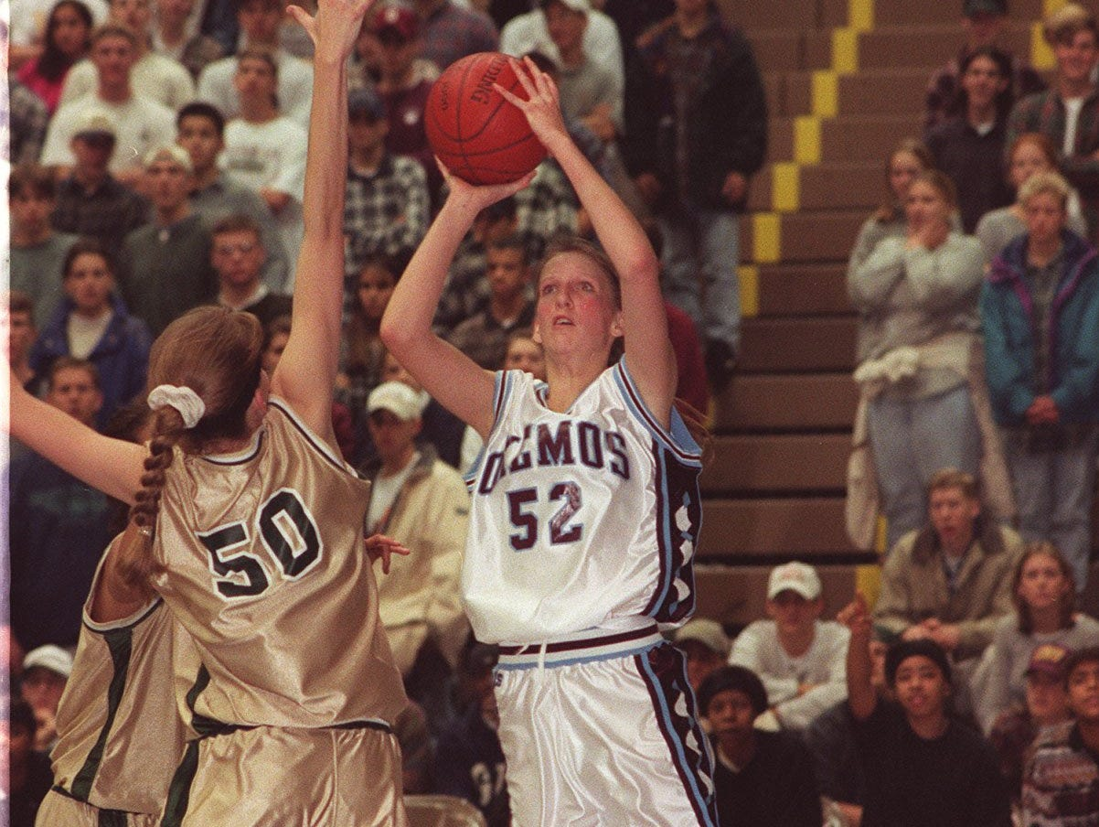 Okemos' Kristen Rasmussen (52) puts up a shot against Ann Arbor Huron during a game in 1995. She was hired as Okemos girls basketball coach Monday.
