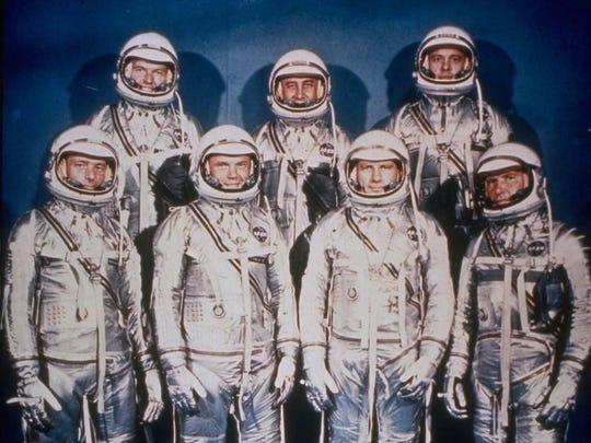 """Front row: Walter Schirra, Donald """"Deke"""" Slayton, John Glenn, Scott Carpenter. Back row: Alan Shepard, Virgil """"Gus"""" Grissom and Gordon Cooper."""