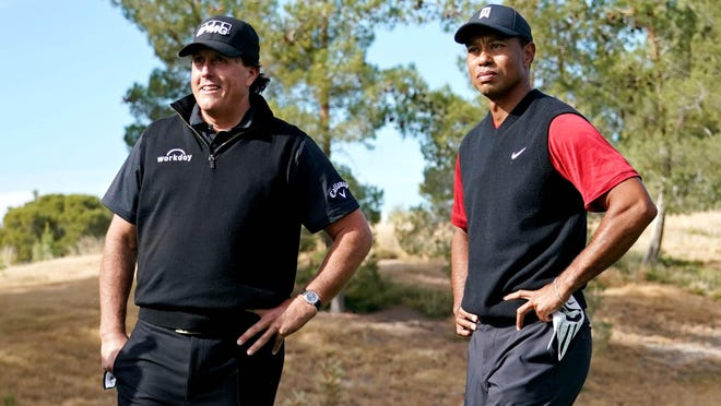 Phil Mickelson and Tiger Woods on the first tee during Tiger vs Phil golf match at Shadow Creek Golf Course in Las Vegas in November.