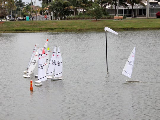 RC Laser boats tighten up as they come around a marker and head for home in a heat race at the North American RC/Laser Regatta Championship at Mackle Park in 2013.