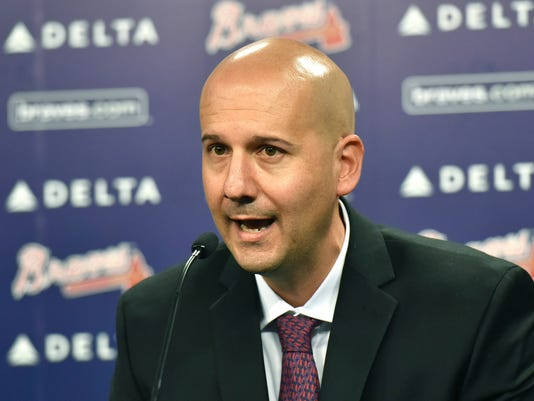 "FILE - In this Oct. 1, 2015, file photo, Atlanta Braves general manager John Coppolella speaks during a news conference at Turner Field in Atlanta. The former Braves general manager apologized Tuesday, Dec. 5, 2017, for rules violations that led to him being banned from baseball for life, saying he's ""disgraced and humbled"" by his actions(Hyosub Shin/Atlanta Journal-Constitution via AP, File)"