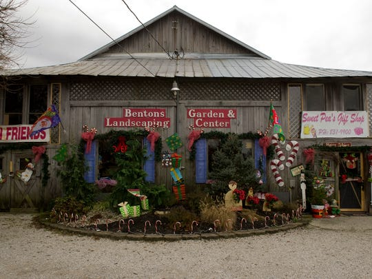 Sweet Pea's Gift Shop was built around an 1860s era two-story log cabin and now offers a multitude of seasonal products.