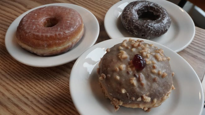 Knead Doughnuts is expanding to  East Greenwich with a lineup that includes vanilla glazed, chocolate cake, and, in front, jelly filled.