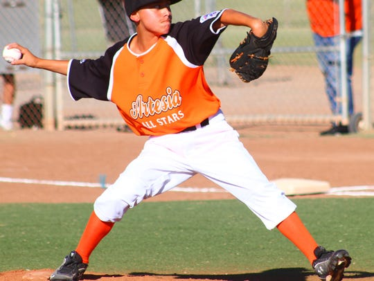 An Artesia pitcher strides toward home plate.