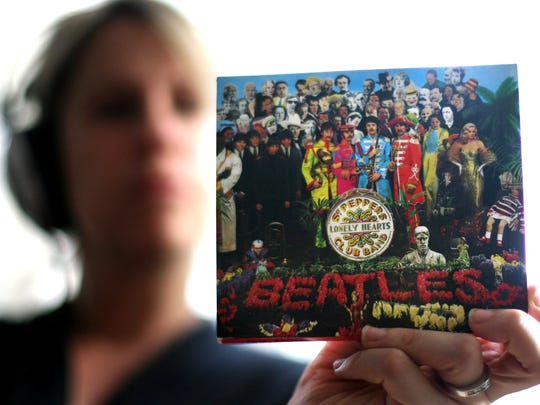"""A copy of the Beatles, """"Sgt Peppers Lonely Hearts Club Band"""" album is held by a listener in London in 2007."""