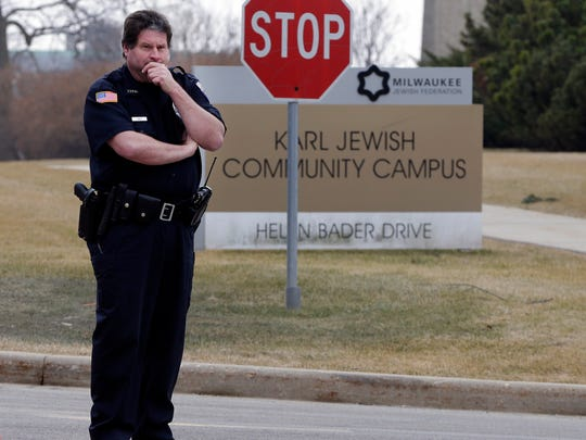 A police officer stands watch at the The Harry & Rose Samson Family Jewish Community Center, 6255 N. Santa Monica Blvd. in Whitefish Bay, as people were evacuated Feb. 20 after the JCC received a phoned-in bomb threat. The JCC also closed the morning of March 7 following an email threat.